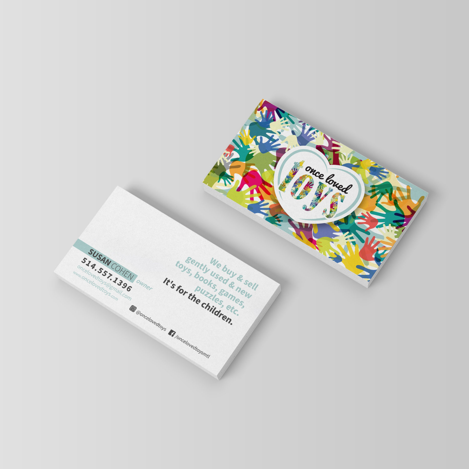 Business card with multiple colourful illustrated hands in green, blue, pink, orange, beige. Text 'It's for the children'.